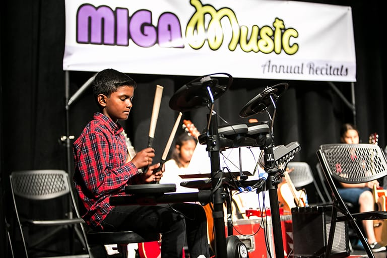 MIGA Music student Sailash playing drums at our Recitals