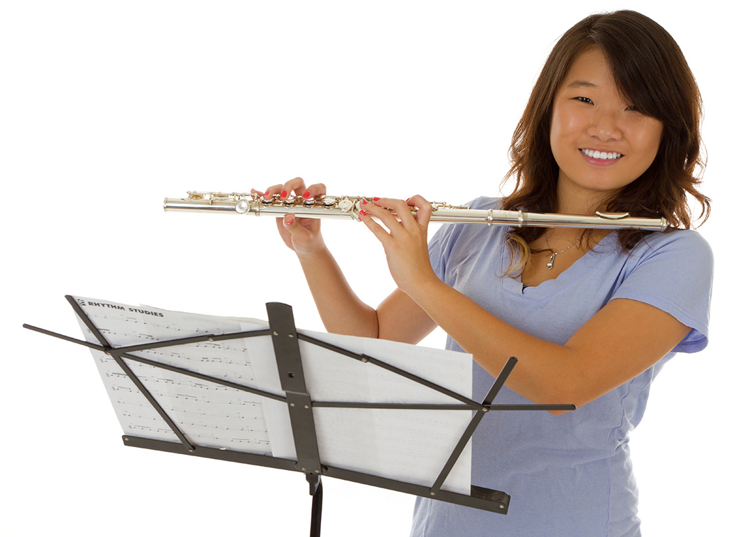 Flute playing girl with a radiating smile