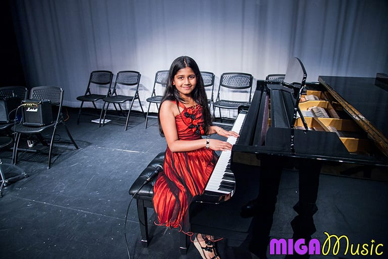 MIGA Music piano student Siddhi at our Recitals in a beautiful red dress
