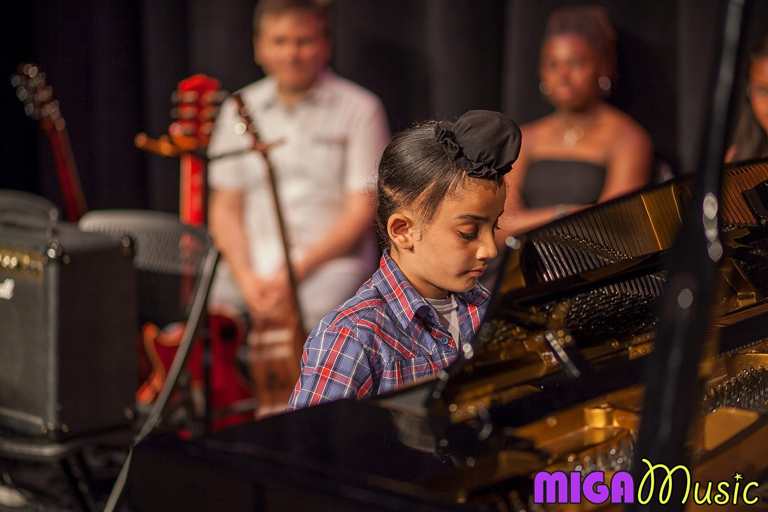 MIGA Music student Romit playing piano at our Recitals