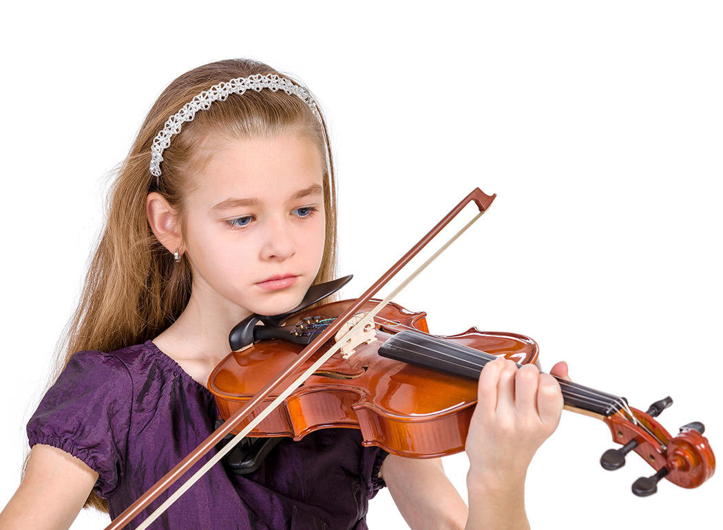 Girl playing a violin and paying attention to it